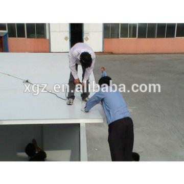 Flat roof steel structure low price prefabricate house